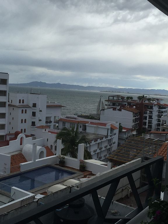 Balcony view to Pier and Banderas Bay. Great sunsets! In the middle of it all.
